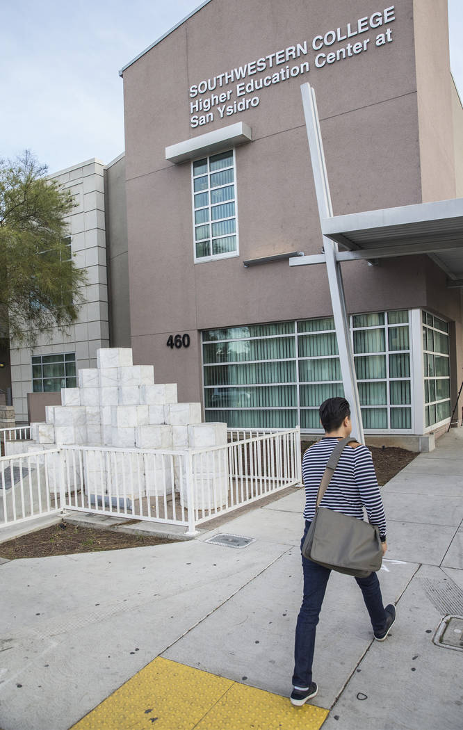 A Student at Southwestern College walks by the monument honoring the victims of the San Ysidro McDonald's massacre on Thursday, March 8, 2018, in San Ysidro, CA. James Huberty shot and killed 21 p ...