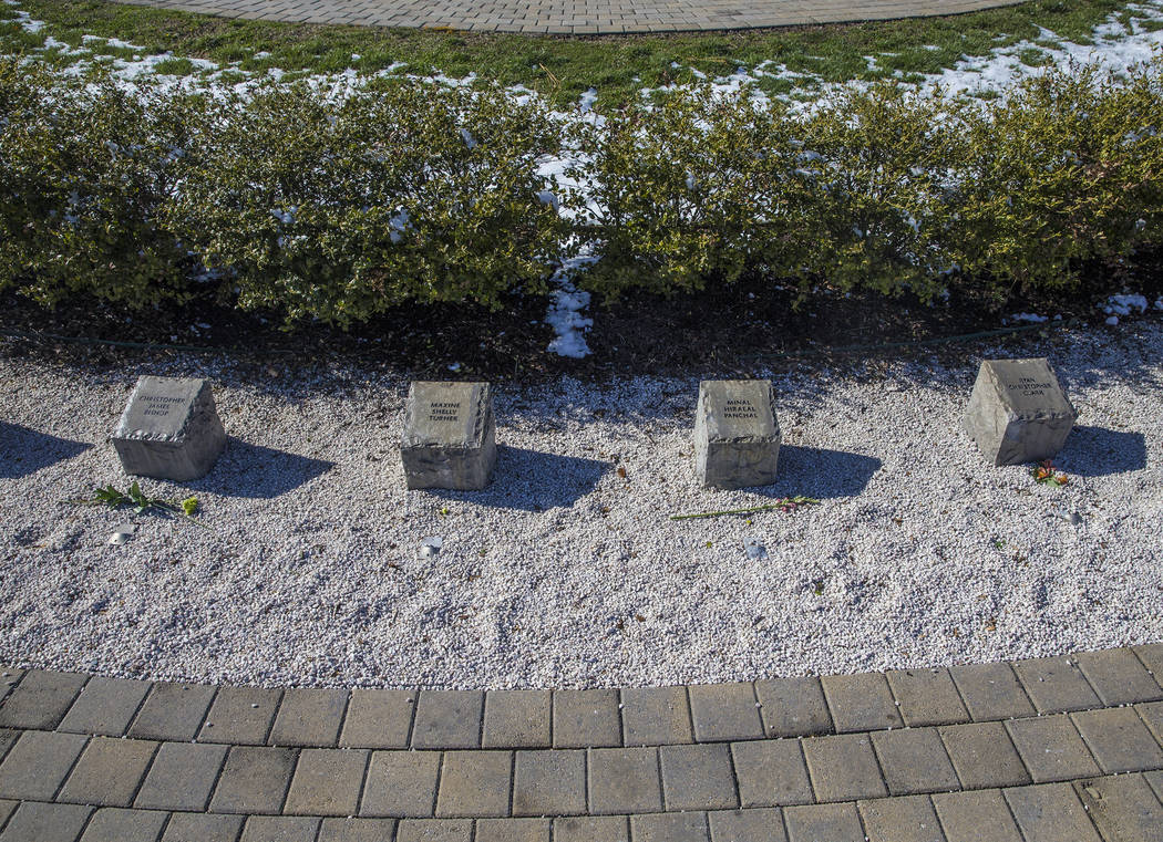 Hokie stones inscribed with the names of those killed during the Virginia Tech shooting form a half circle around the April 16 Memorial on Thursday, March 22, 2018, at Virginia Tech University, in ...