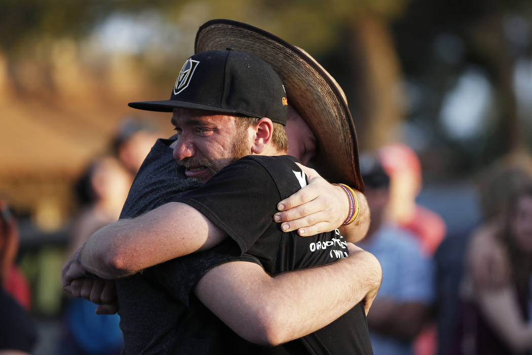 Zach Laswell, 20, and Bailey Thompson, 18, embrace during the Route 91 Candlelight Vigil near Mandalay Bay in Las Vegas on Sunday, April 1, 2018. Andrea Cornejo Las Vegas Review-Journal @dreacornejo