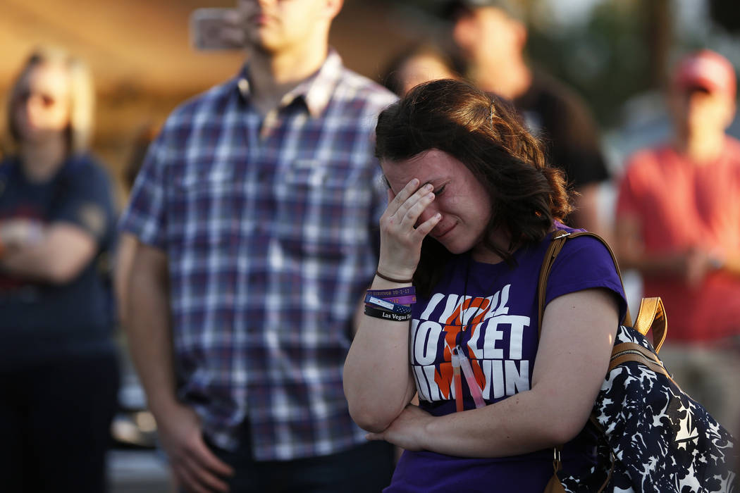 Alaina Laswell, 23, reacts during the Route 91 Candlelight Vigil near Mandalay Bay in Las Vegas on Sunday, April 1, 2018. Andrea Cornejo Las Vegas Review-Journal @dreacornejo
