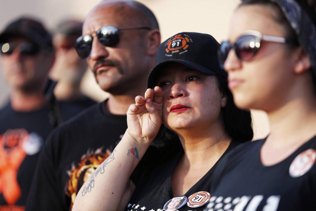 Attendees react during the Route 91 Candlelight Vigil near Mandalay Bay in Las Vegas on Sunday, April 1, 2018. Andrea Cornejo Las Vegas Review-Journal @dreacornejo