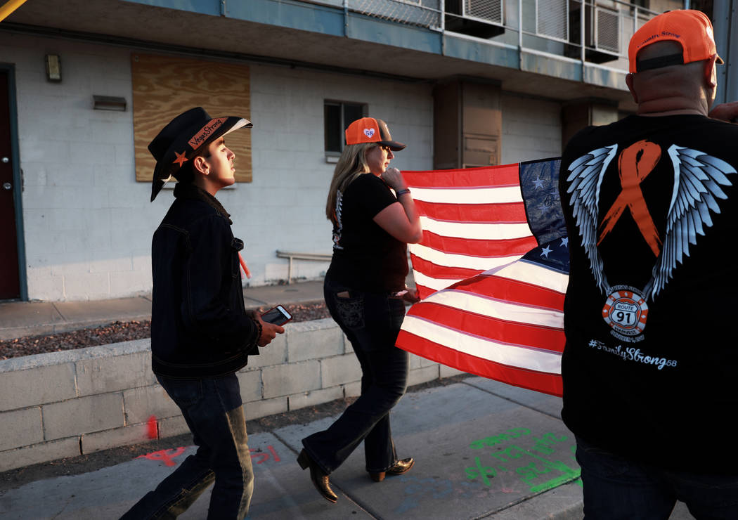 Axel Martinez, 13, marches behind Kimberly Dalrymple and her husband Anthony during the Route 91 Candlelight Vigil near Mandalay Bay in Las Vegas on Sunday, April 1, 2018. Andrea Cornejo Las Vegas ...