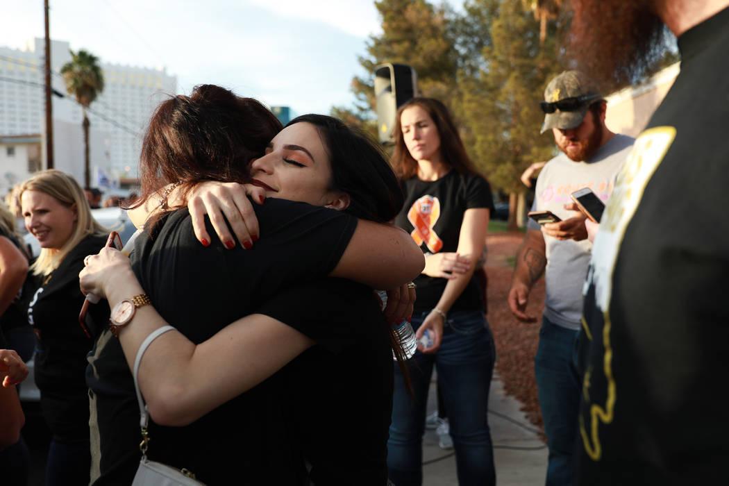Nina Mendoza, 23, embraces Shelly Kerbrat during the Route 91 Candlelight Vigil near Mandalay Bay in Las Vegas on Sunday, April 1, 2018. Andrea Cornejo Las Vegas Review-Journal @dreacornejo