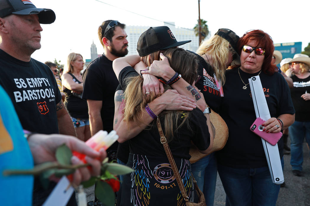 From left, Priscilla Solorzano, a woman who did not wish to be identified, Tara Rietveld, and Leah Tuckman embrace each other during the Route 91 Candlelight Vigil near Mandalay Bay in Las Vegas o ...