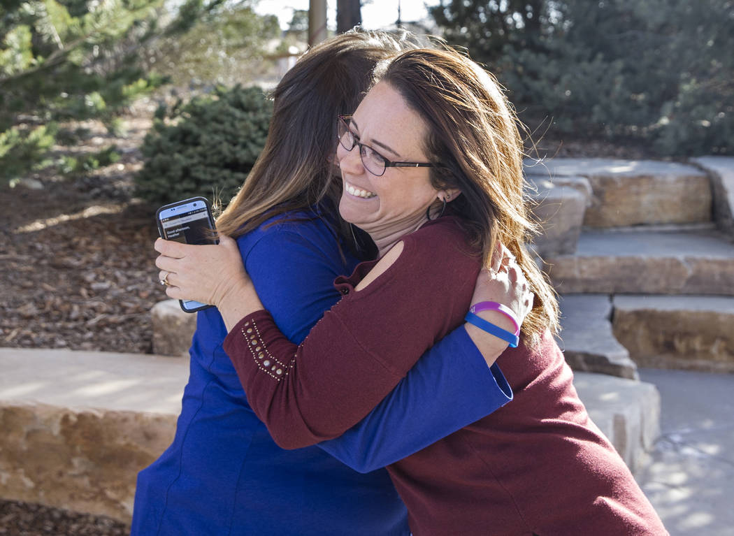 Heather Dearman, right, hugs Theresa Hoover at the Reflection Memorial Garden on Tuesday, March 13, 2018, in Aurora, CO. Dearman's cousin was shot and paralyzed and Hoover's son A.J. Boik was kill ...