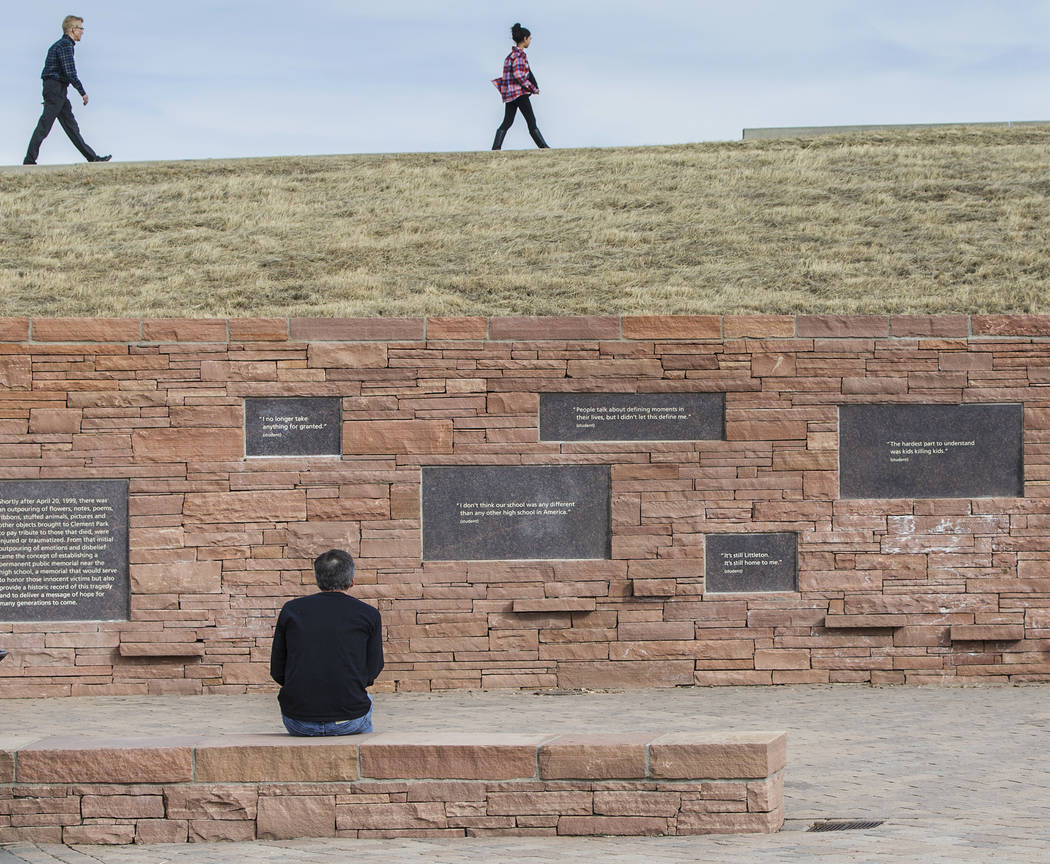 Visitors read quotes from those affected by the Columbine school shooting on the walls of the Columbine Memorial  on Wednesday, March 14, 2018, in Littleton, CO. Benjamin Hager Las Vegas Review-Jo ...