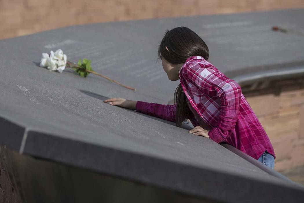 Ava Gallegos reads inscriptions honoring victims of the Columbine school shooting on Wednesday, March 14, 2018, at the Columbine Memorial, in Littleton, CO. Benjamin Hager Las Vegas Review-Journal ...