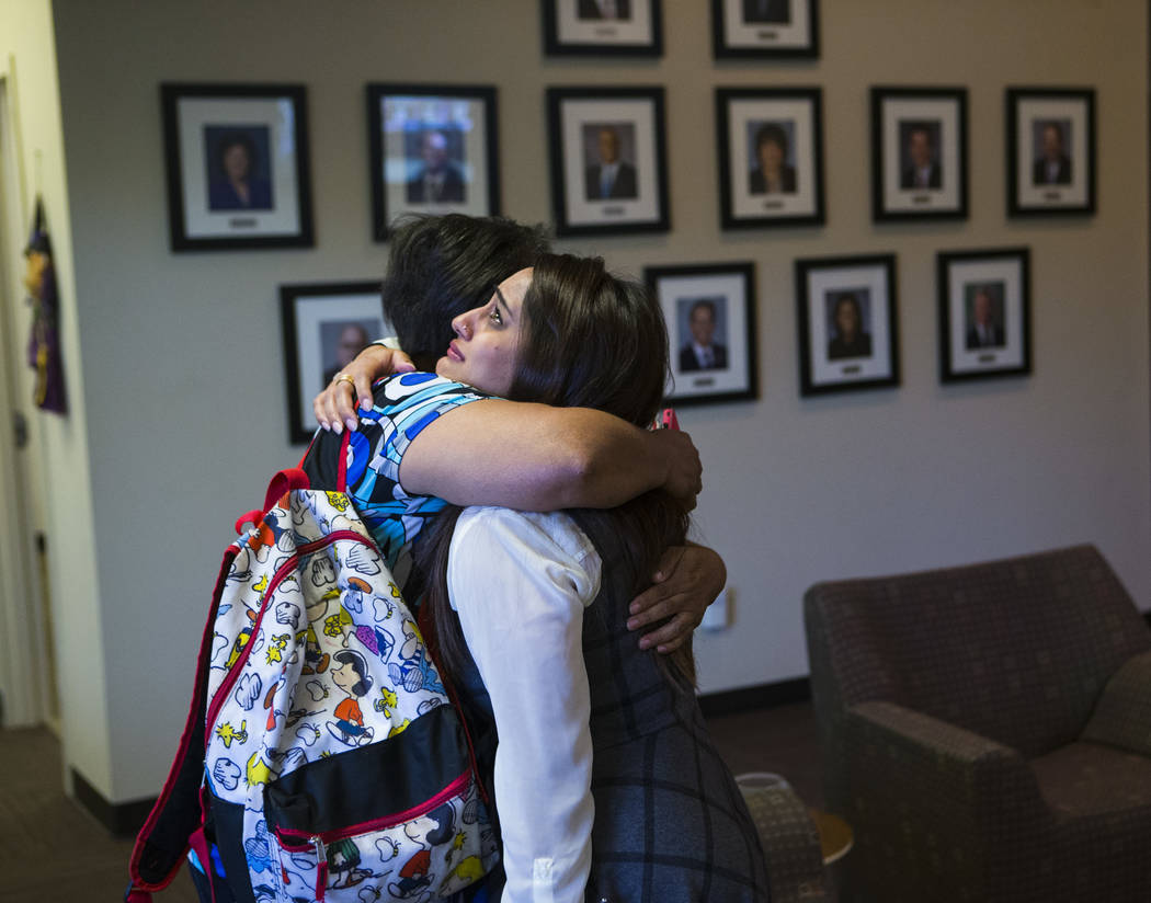 Simona Johnson, mother of a daughter with HIV, left, embraces Dina Patel, a nurse practitioner at the pediatric HIV program at UNLV's School of Community Health Sciences, after attending a meeting ...