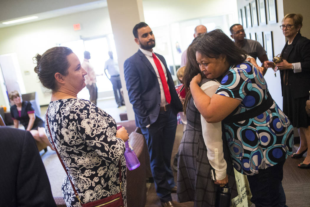Simona Johnson, mother of a daughter with HIV, far right, embraces Dina Patel, a nurse practitioner at the pediatric HIV program at UNLV's School of Community Health Sciences, after attending a me ...