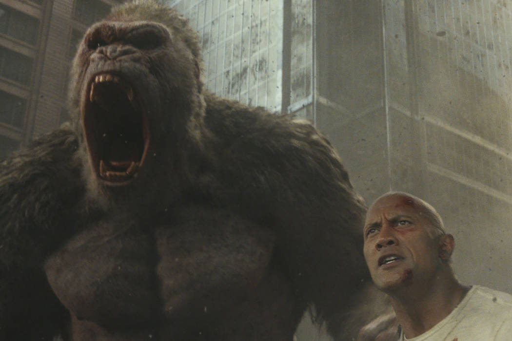 "Photo Credit: Courtesy of Warner Bros. Pictures Caption: (L-R) JASON LILES as George and DWAYNE JOHNSON as Davis Okoye in New Line Cinema's and ASAP Entertainment's action adventure ""RAMPAGE ..."