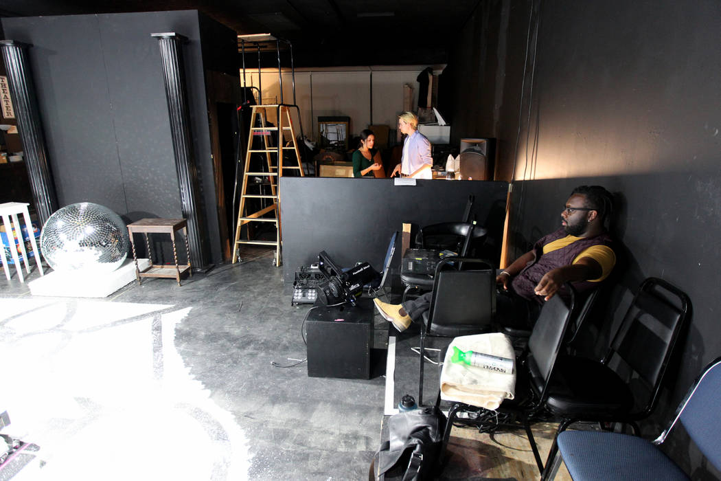 "Crew members, from left, co-stage manager Mckenna Castro, co-stage manager Josh O'Brien and lighting designer Marcus Randolph prepare for a rehearsal of Majestic Repertory Theatre's ""Marie An ..."