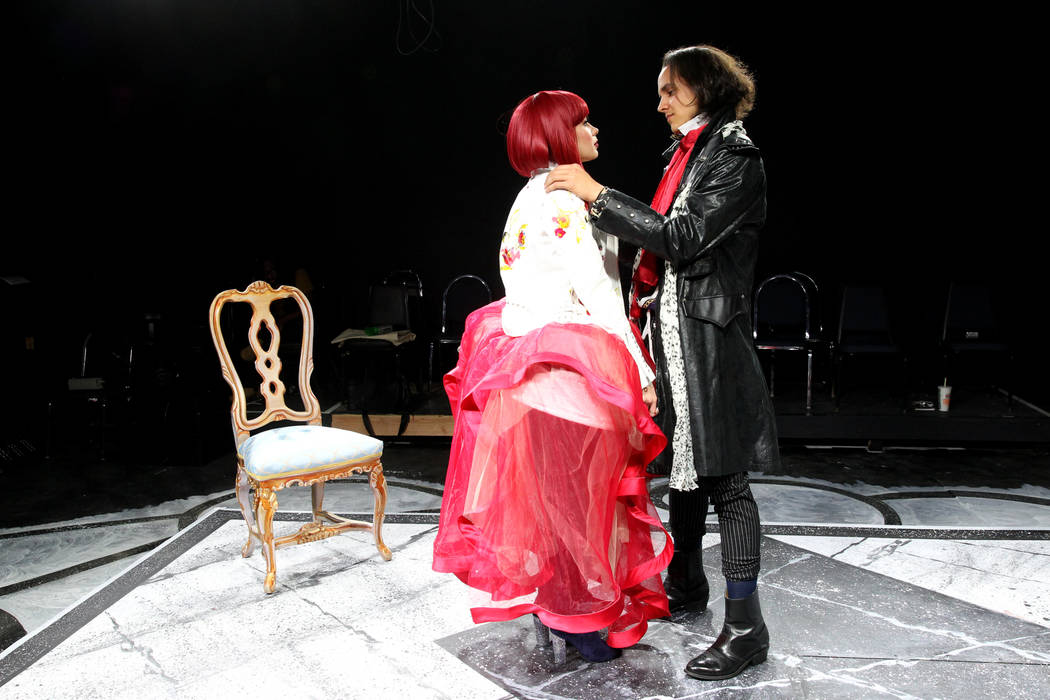 "Christopher Cipollini as Axel Fersen, right, and Katie Marie Jones as Marie Antoinette during a rehearsal for Majestic Repertory Theatre's ""Marie Antoinette"" at the downtown Las Vegas th ..."