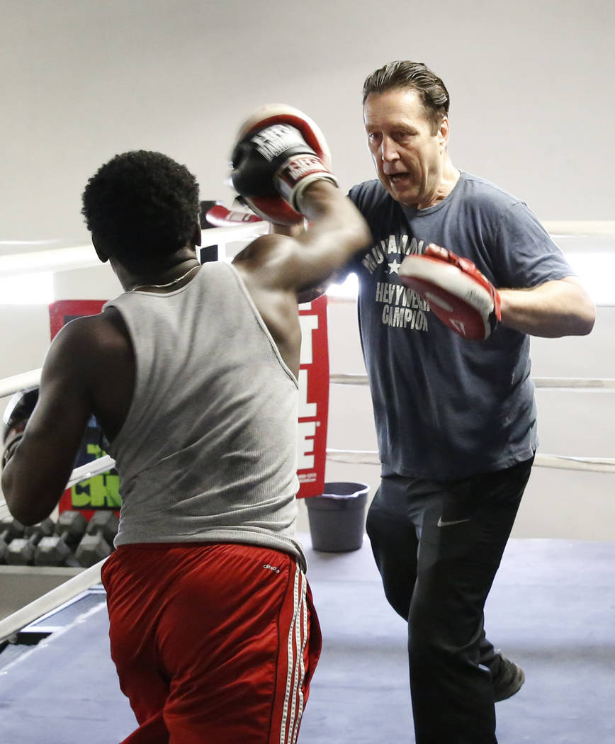 Armin Van Damme, owner of City Athletic Boxing, right, works with a boxer from the Spring Mountain Youth Camp training on Monday, April 2, 2018, in Las Vegas. Bizuayehu Tesfaye/Las Vegas Review-Jo ...
