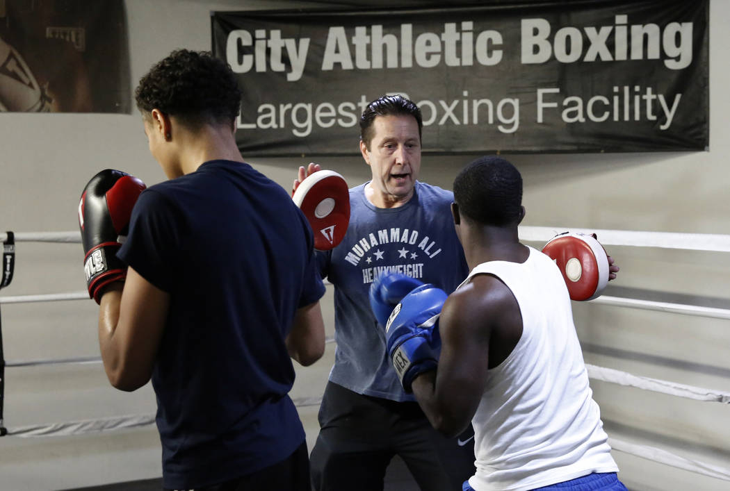Armin Van Damme, owner of City Athletic Boxing, center, works with the boys from the Spring Mountain Youth Camp training on Monday, April 2, 2018, in Las Vegas. Bizuayehu Tesfaye/Las Vegas Review- ...