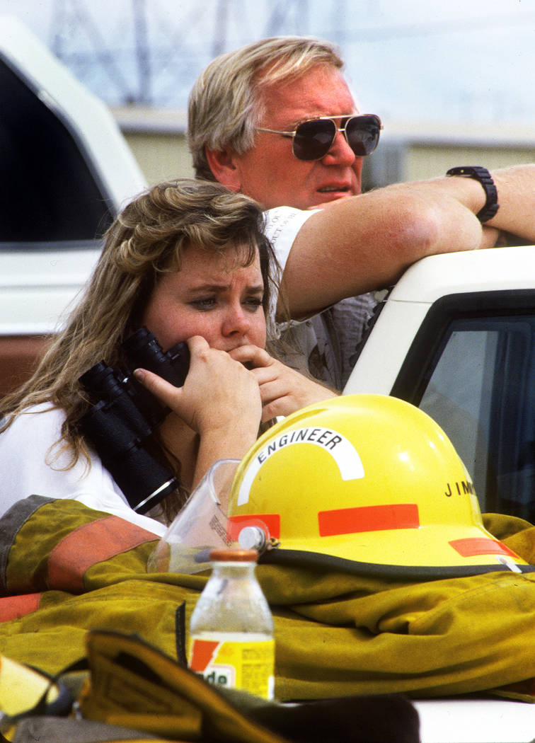 Kendra Brown and Pat Hinds watch the scene at the PEPCON plant in Henderson on May 4, 1988, after a fire and explosion rocked the Las Vegas Valley. Their business, Unicorn Sailing Center, located ...