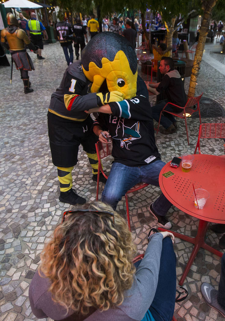 3a387a5f3f06 Golden Knights mascot Chance interacts with a San Jose Sharks fan during a  pregame parade at