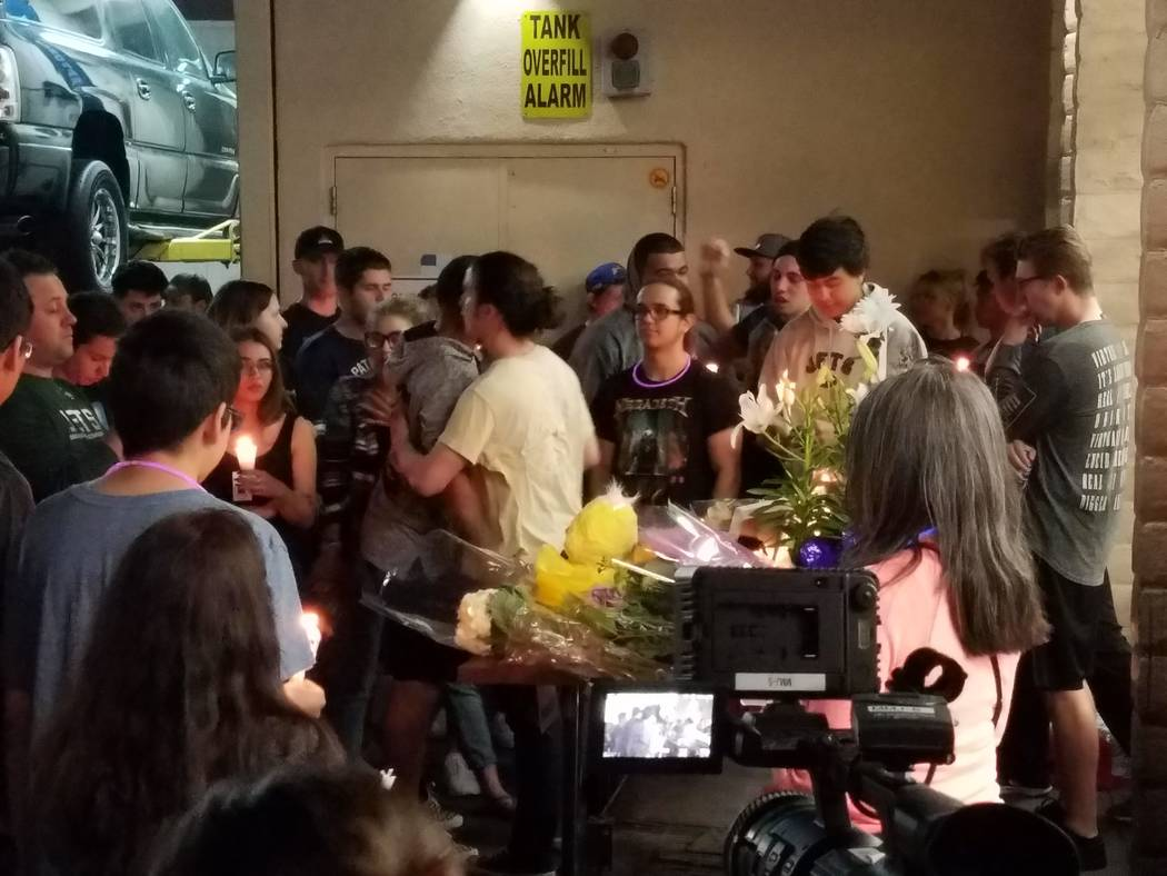 Friends and family attend a vigil for Zach Ragusa, who was killed in a shooting Friday morning at Terrible's Car Wash & Lube in Henderson. The vigil was held Saturday, March 31, 2018, outside th ...