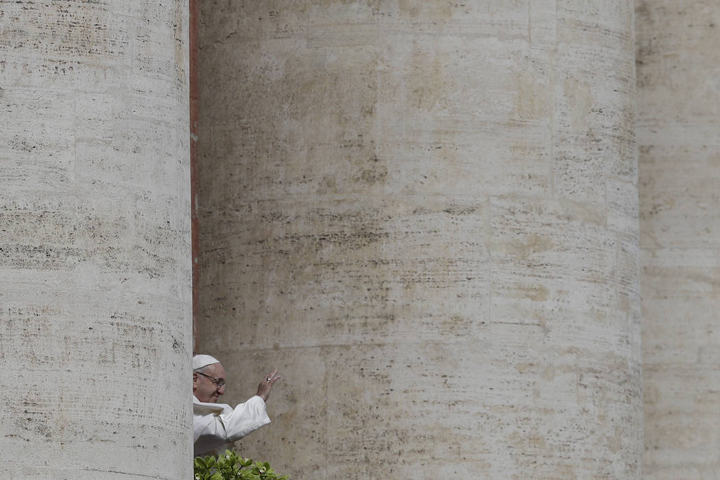 Pope Francis delivers his Urbi et Orbi (to the city and to the world) message from the main balcony of St. Peter's Basilica, at the Vatican, Sunday, April 1, 2018. (AP Photo/Gregorio Borgia)