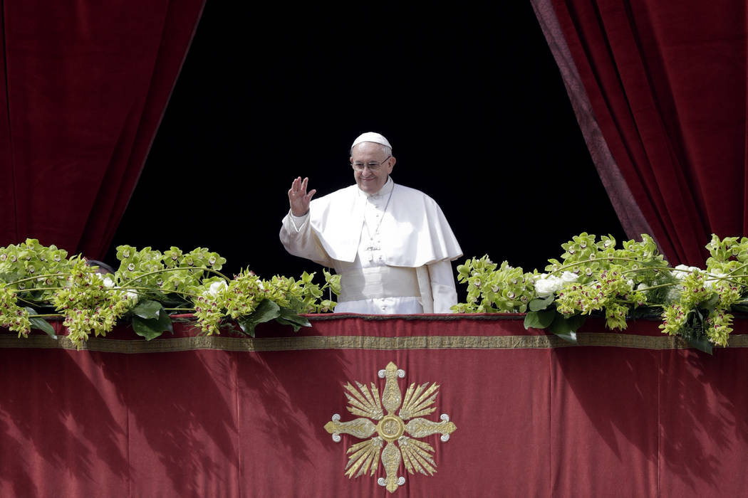 Pope Francis delivers the Urbi et Orbi (to the city and to the world) blessing at the end of the Easter Sunday Mass in St. Peter's Square at the Vatican, Sunday, April 1, 2018. (AP Photo/Andrew Me ...