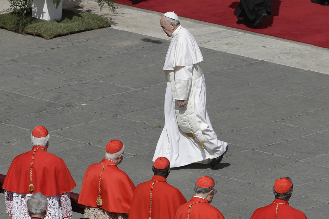 Pope Francis leaves after leading the Easter Mass in St. Peter Square at the Vatican, Sunday, April 1, 2018. (AP Photo/Gregorio Borgia)