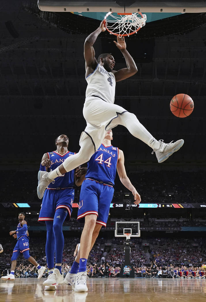 Villanova's Eric Paschall (4) dunks during the second half in the semifinals of the Final Four NCAA college basketball tournament against Kansas, Saturday, March 31, 2018, in San Antonio. (AP Phot ...