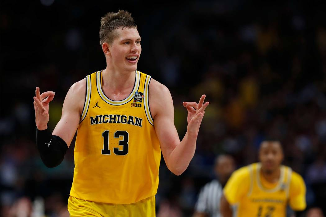 Michigan's Moritz Wagner (13) reacts after scoring a 3-point shot against Loyola-Chicago during the second half in the semifinals of the Final Four NCAA college basketball tournament, Saturday, Ma ...