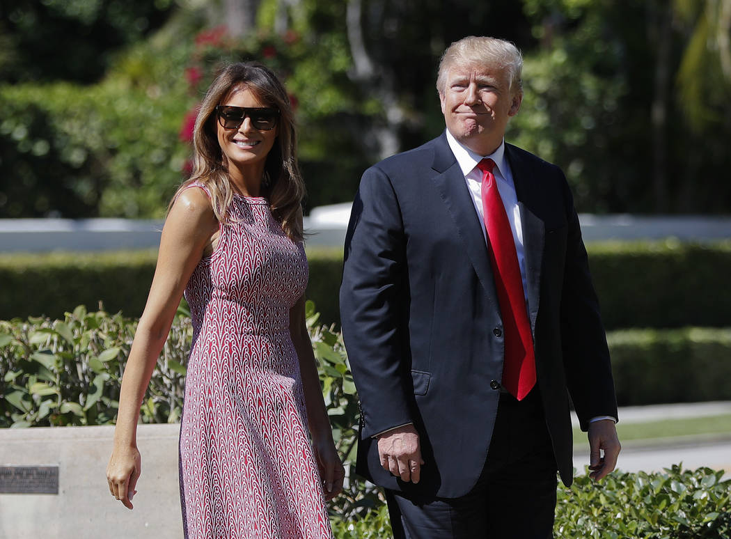 President Donald Trump and first lady Melania Trump arrive for Easter services at Episcopal Church of Bethesda-by-the-Sea in Palm Beach, Fla., Sunday, April 1, 2018. (AP Photo/Pablo Martinez Monsi ...