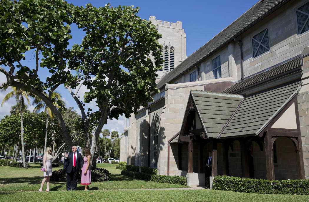 President Donald Trump stops to talk to members of the media as he arrives for Easter services with his daughter Tiffany Trump, left, and first lady Melania Trump at Episcopal Church of Bethesda-b ...