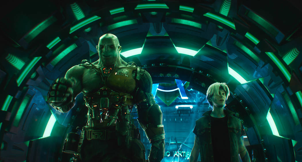 "This cover image released by Warner Bros. Pictures shows characters Aech, left, and Parzival in a scene from ""Ready Player One,"" a film by Steven Spielberg. (Warner Bros. Pictures via AP)"