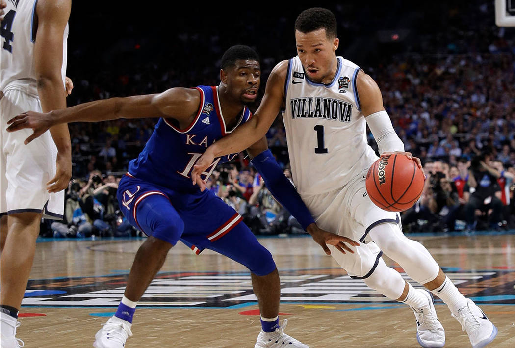 Villanova guard Jalen Brunson (1) drives past Kansas guard Malik Newman during the second half in the semifinals of the Final Four NCAA college basketball tournament, Saturday, March 31, 2018, in  ...