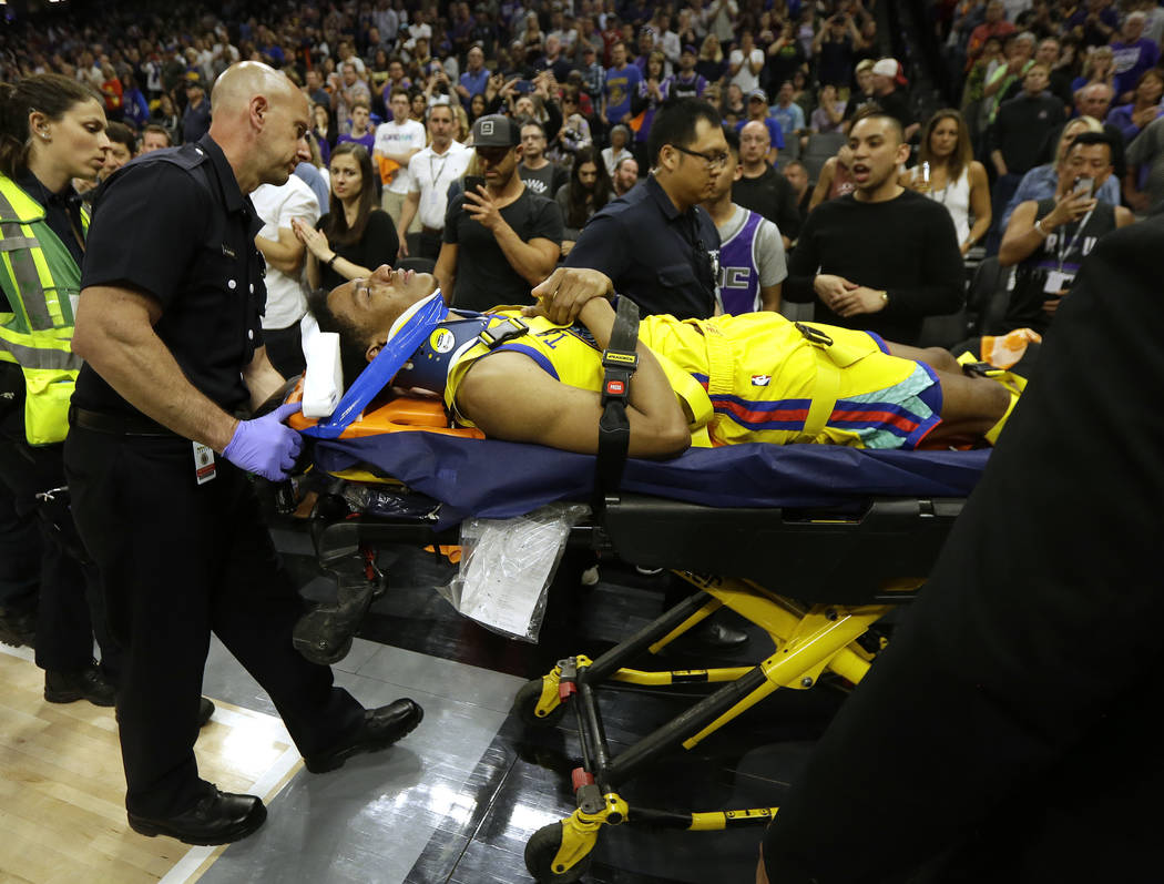 Golden State Warriors guard Patrick McCaw is taken off the court on a stretcher after falling hard to the floor late in the third quarter following a Flagrant 1 foul by Sacramento Kings's Vince Ca ...
