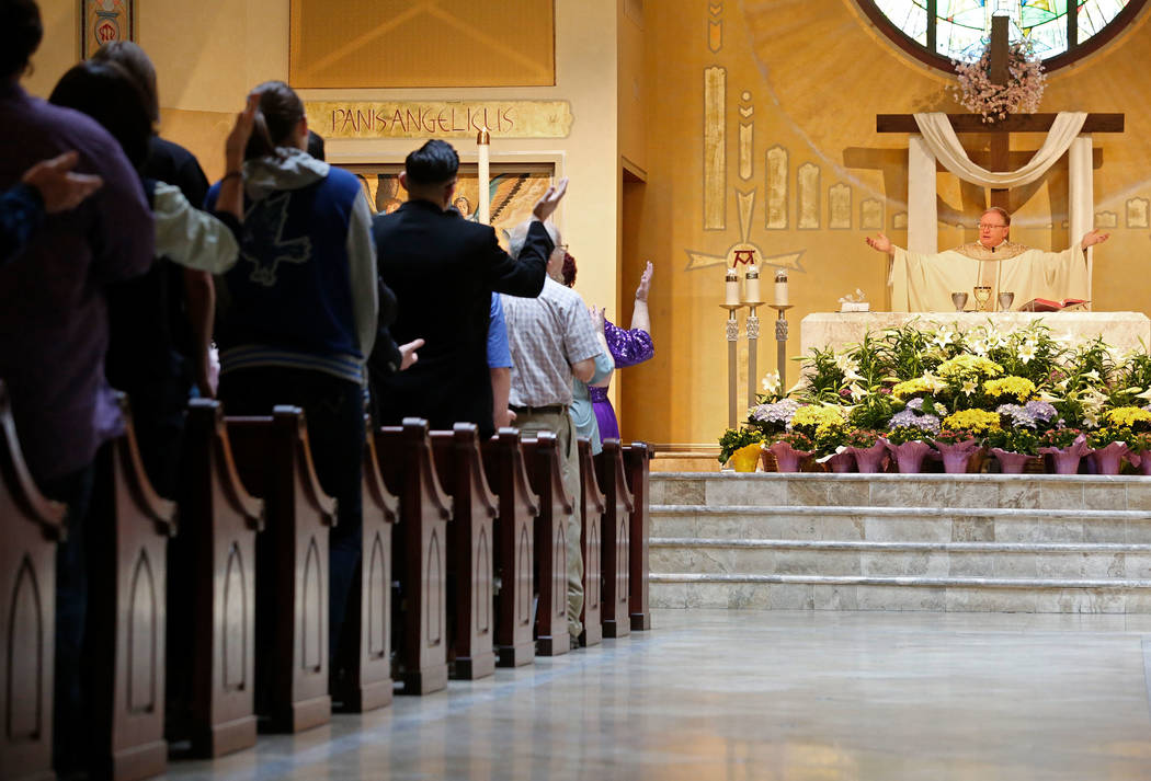 The Rev. Gerald Grupczynski, pastor of Our Lady of Las Vegas Roman Catholic Church, right, holds an Easter Mass at the church in Las Vegas, Sunday, April 1, 2018. Chitose Suzuki Las Vegas Review-J ...