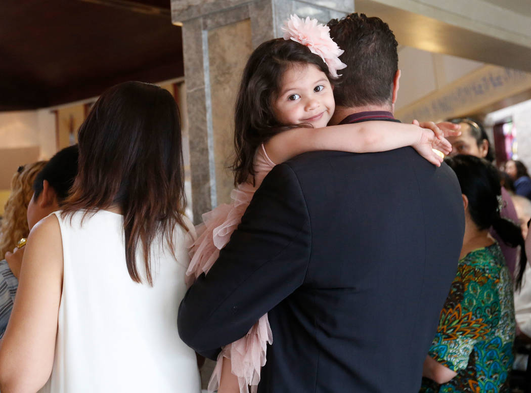 Toni Testa, 4, of Las Vegas attends an Easter Mass at Our Lady of Las Vegas Roman Catholic Church in Las Vegas, Sunday, April 1, 2018, with her father Mark. Chitose Suzuki Las Vegas Review-Journal ...
