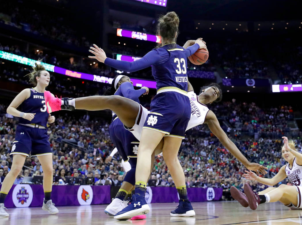 Mississippi State's Teaira McCowan and Notre Dame's Kathryn Westbeld (33) reach for a rebound during the second half in the final of the women's NCAA Final Four college basketball tournament, Sund ...