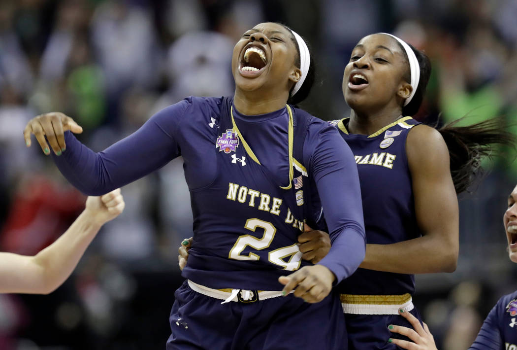 Notre Dame's Arike Ogunbowale, left, is congratulated by teammate Jackie Young after sinking a 3-point basket to defeat Mississippi State 61-58 in the final of the women's NCAA Final Four college  ...