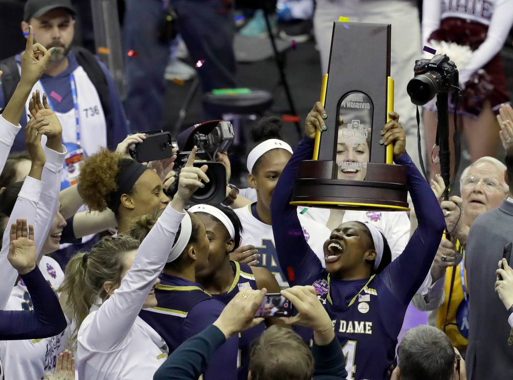 Notre Dame's Arike Ogunbowale holds the trophy after defeating Mississippi State in the final of the women's NCAA Final Four college basketball tournament, Sunday, April 1, 2018, in Columbus, Ohio ...