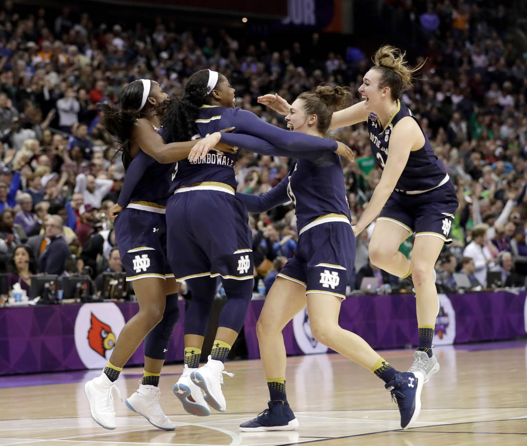 Members of Notre Dame celebrate after defeating Mississippi State in the final of the women's NCAA Final Four college basketball tournament, Sunday, April 1, 2018, in Columbus, Ohio. Notre Dame wo ...