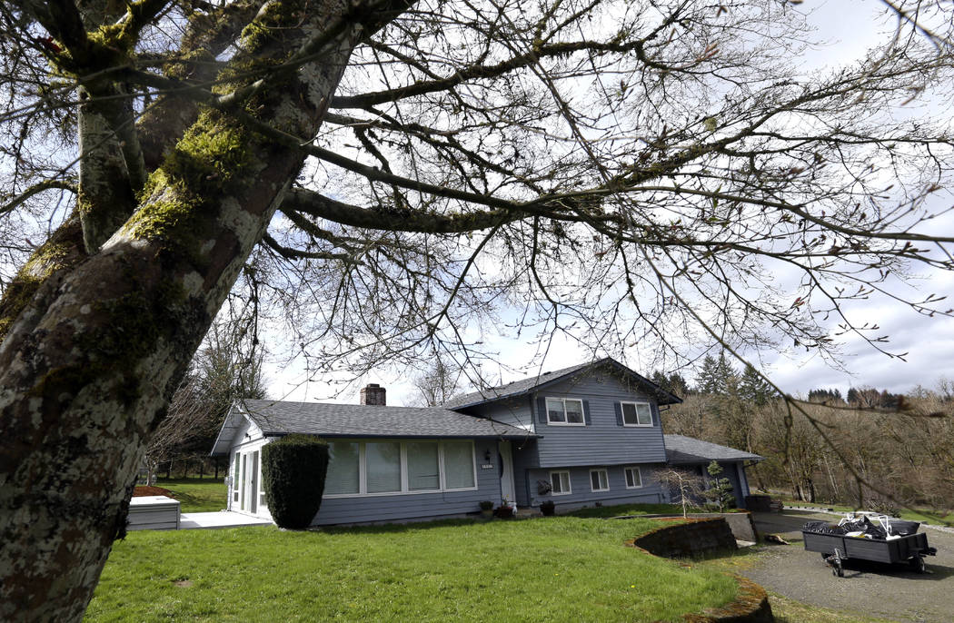 This photo taken Wednesday, March 28, 2018, shows the house in Woodland, Wash., where the Hart Family lived. (AP Photo/Don Ryan)