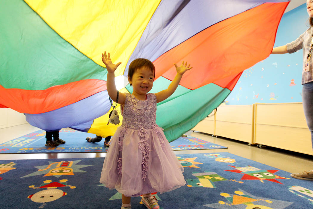 Emy Ma, 2, plays under a parachute during Storytime at Clark County Library on Flamingo Road near Maryland Parkway Monday, April 2, 2018. K.M. Cannon Las Vegas Review-Journal @KMCannonPhoto