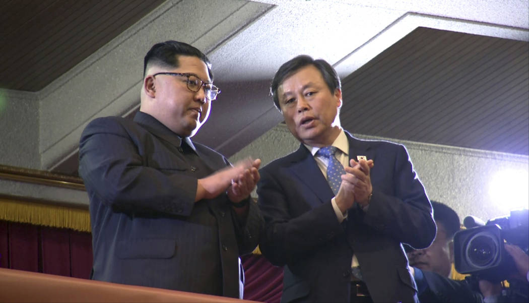 In this Sunday, April 1, 2018, image from video, North Korean leader Kim Jong Un, left, claps with South Korean Culture, Sports and Tourism Minister Do Jong-whan during a performance by a South Ko ...