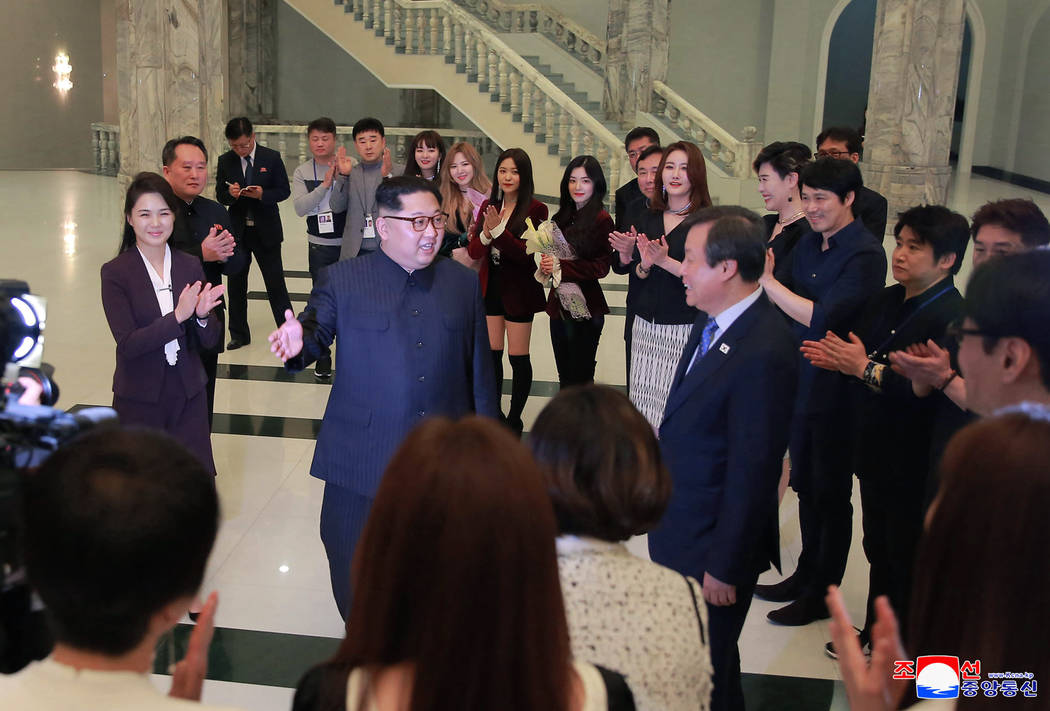 In this photo provided by the North Korean government, North Korean leader Kim Jong Un, center left, talks with South Korean Culture, Sports and Tourism Minister Do Jong-whan, center right, as his ...