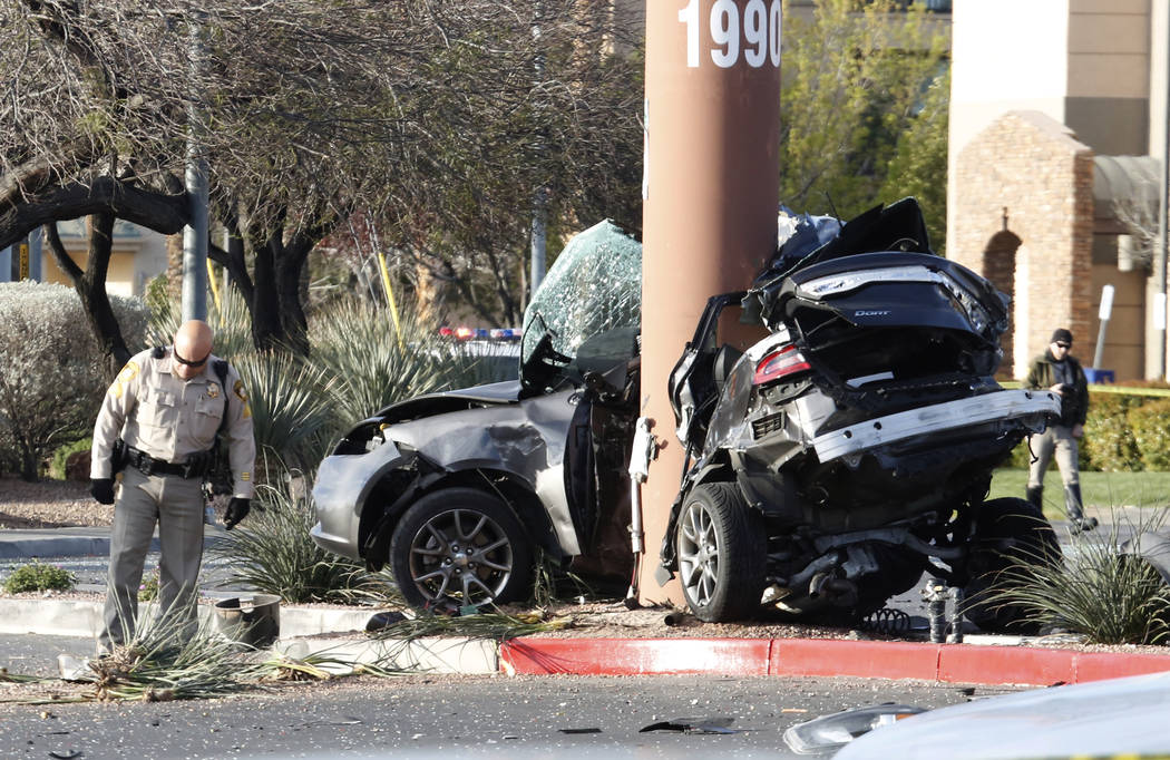 Las Vegas police are investigating a fatal crash at Rainbow and Lake Mead boulevards on Monday, March 26, 2018, in Las Vegas. Police are looking for one person who ran from the scene.  Bizuayehu T ...