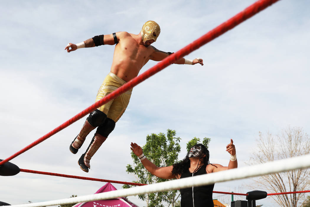 Rey Horus wrestles Bestia 666 during the first Tacos and Tamales Festival, organized by the Clark County Parks and Recreation, at Sunset Park in Las Vegas on Saturday, March 31, 2018. The event fe ...