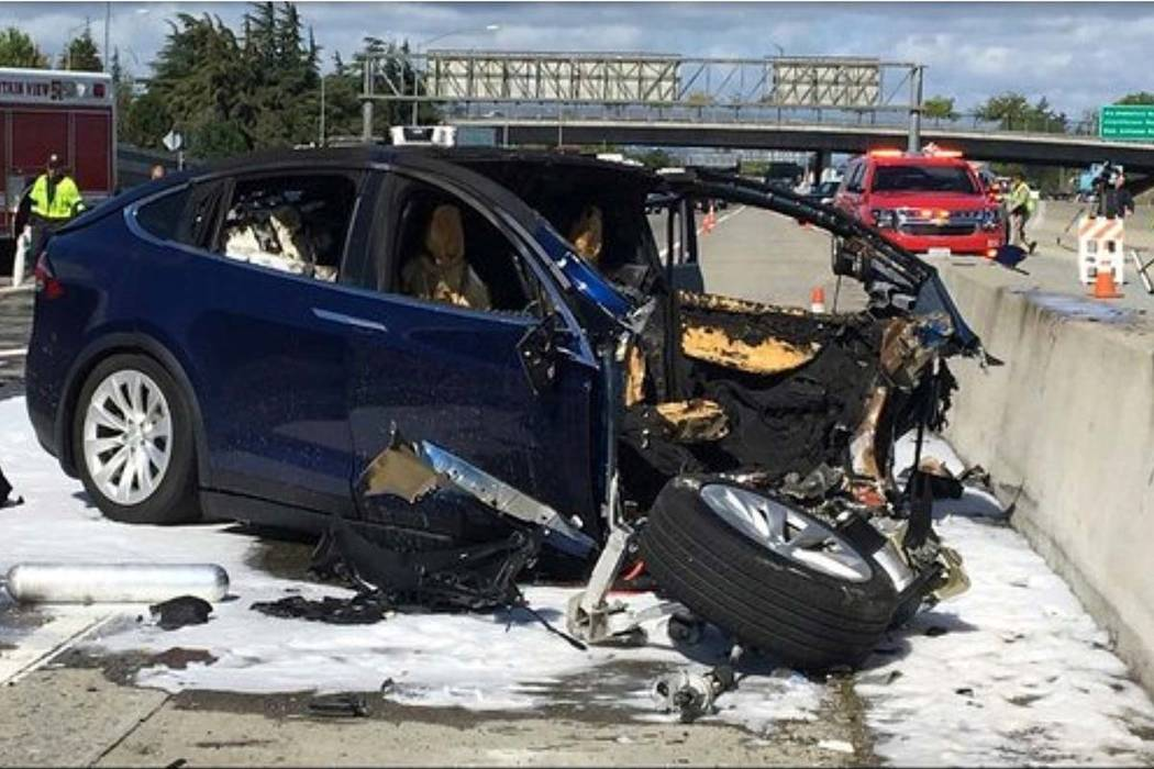 In this March 23, 2018 file photo provided by KTVU-TV, emergency personnel work a the scene where a Tesla electric SUV crashed into a barrier on U.S. Highway 101 in Mountain View, California. (KTV ...