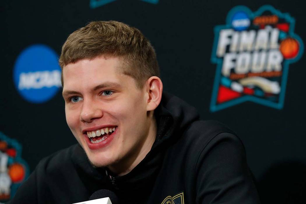 Michigan's Moritz Wagner answers questions during a news conference for the championship game of the Final Four NCAA college basketball tournament, Sunday, April 1, 2018, in San Antonio. (Charlie  ...