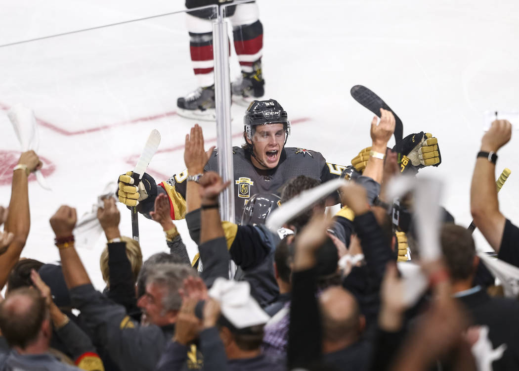 Vegas Golden Knights left wing Erik Haula (56) celebrates with fans after Knights defenseman Deryk Engelland (5) scored a goal during the first period of an NHL hockey game between the Vegas Golde ...