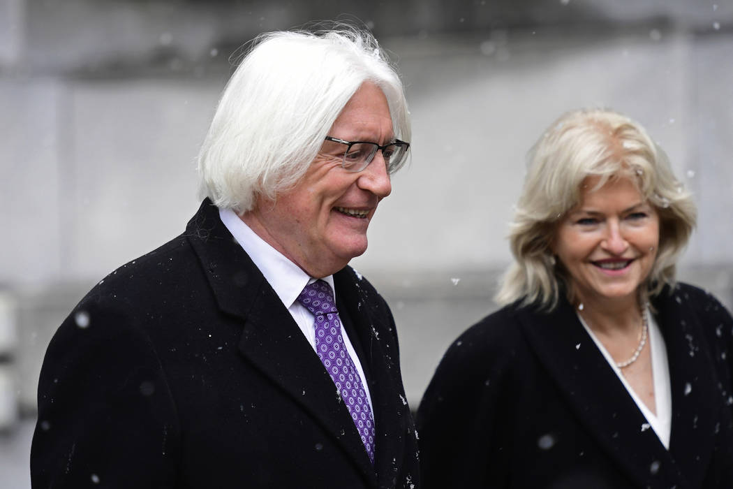 Tom Mesereau, left, and Kathleen Bliss, lawyers for actor and comedian Bill Cosby, not shown, arrive for jury selection in Cosby's sexual assault retrial at the Montgomery County Courthouse, Monda ...