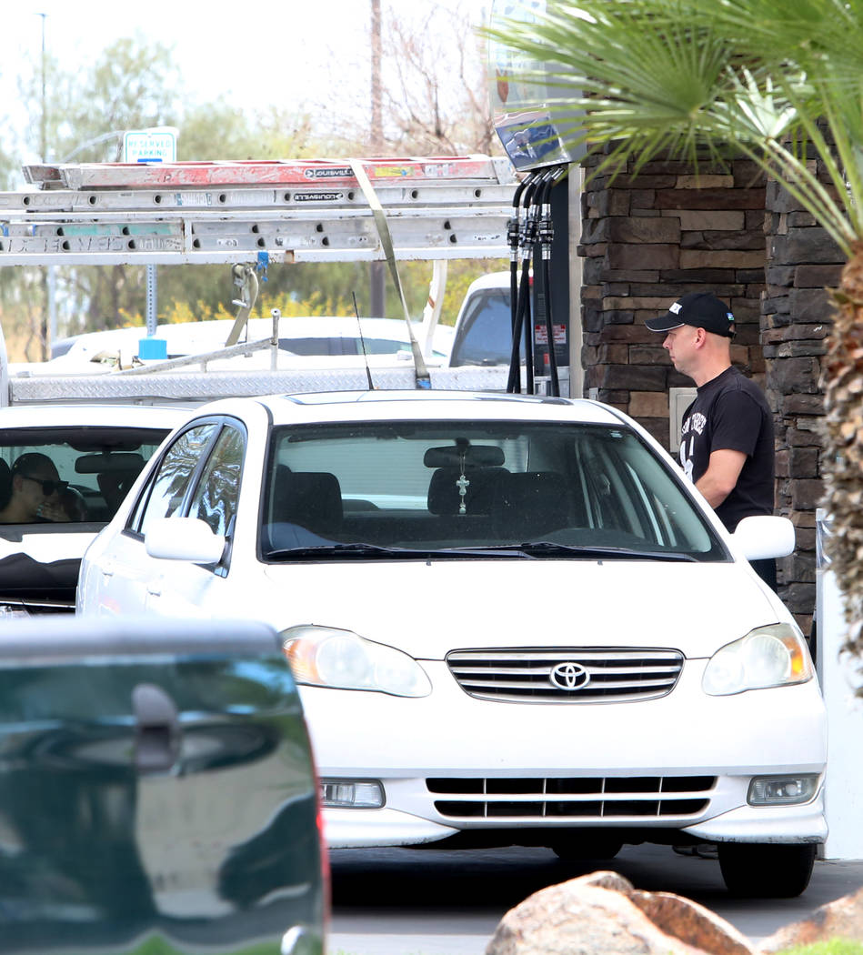 A customer pumps gas at Chevron gas station at the intersection of Tropical Avenue and Fort Apache Road on Monday, April 2, 2018, in Las Vegas. (Bizuayehu Tesfaye/Las Vegas Review-Journal) @bizute ...