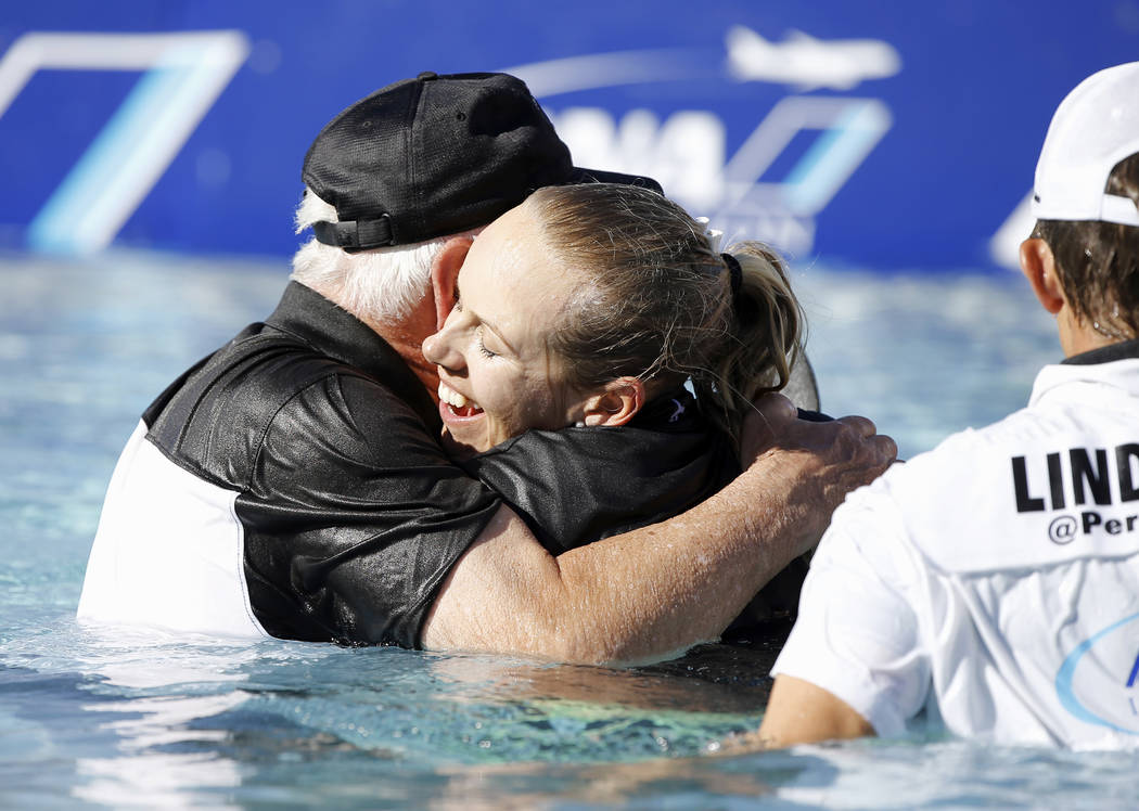 Pernilla Lindberg, of Sweden, hugs her father Jan Lindberg after jumping into the pond after defeating Inbee Park on the tenth hole during the eighth playoff round of the LPGA Tour ANA Inspiration ...