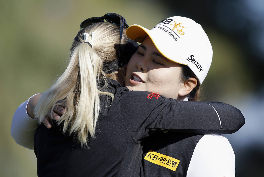 Inbee Park, right, of South Korea, hugs Pernilla Lindberg, of Sweden, after Park missed a birdie putt on the 10th hole during the eighth playoff round of the LPGA Tour ANA Inspiration golf tournam ...